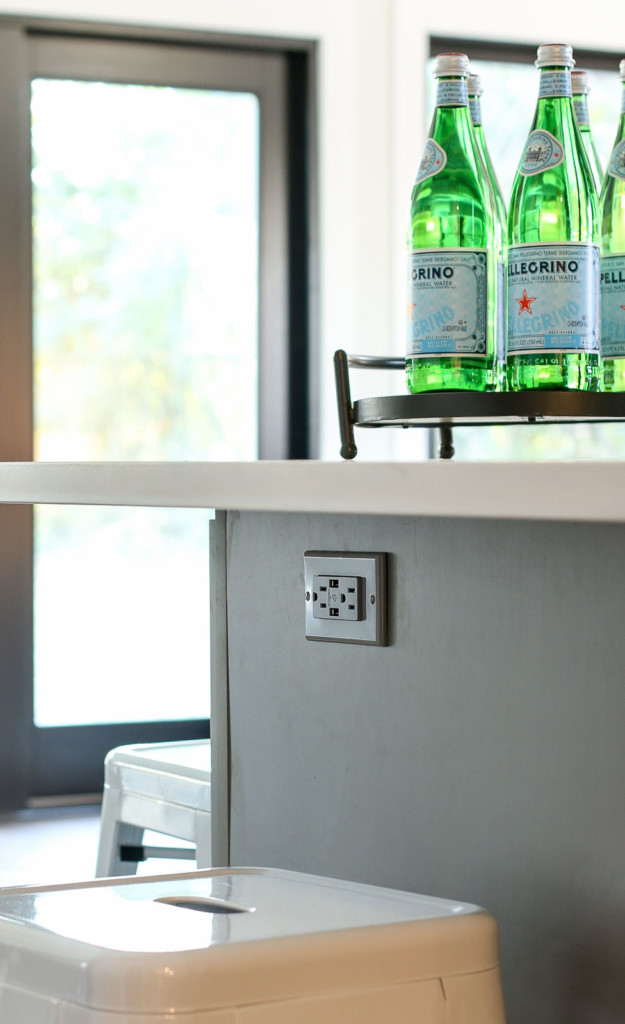 gray usb charging outlet in gray island cabinets