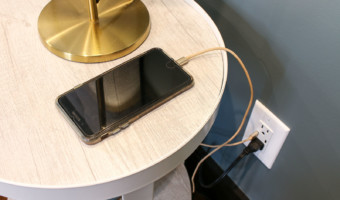 iphone charging by bedside usb charging outlet