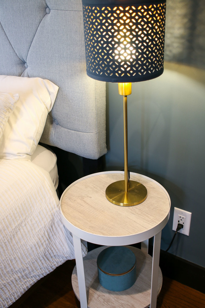 usb charging outlet next to bedside table in master bedroom