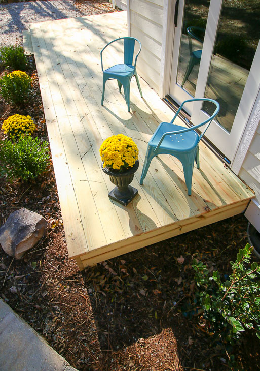 lovely photo of deck and low landscaping plants around deck