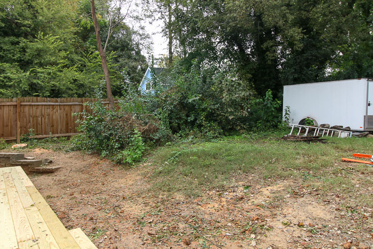 before backyard transformation with trailer and dirt hill