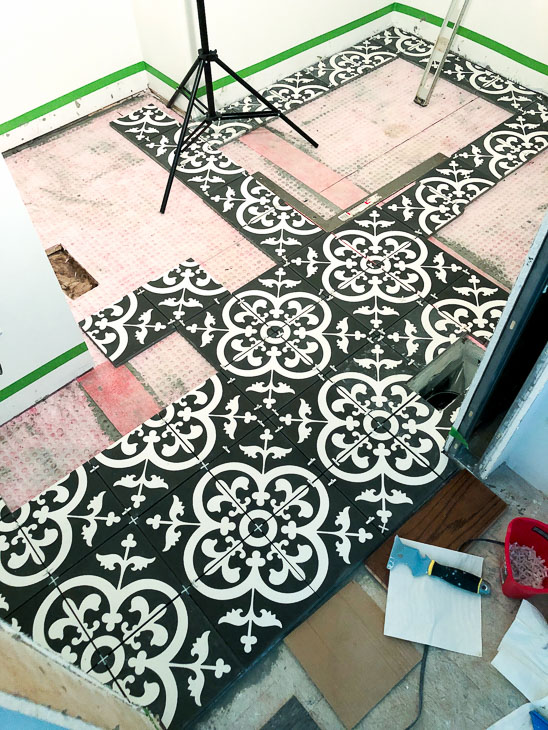 Dry run. Layout cement tiles before installation