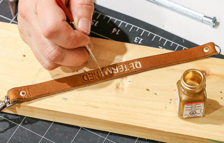 painting gold letters on leather bracelet