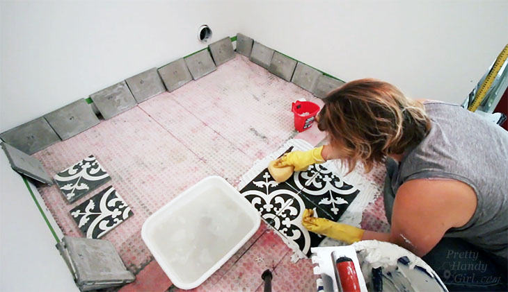 Lay first four tiles in thinset mortar