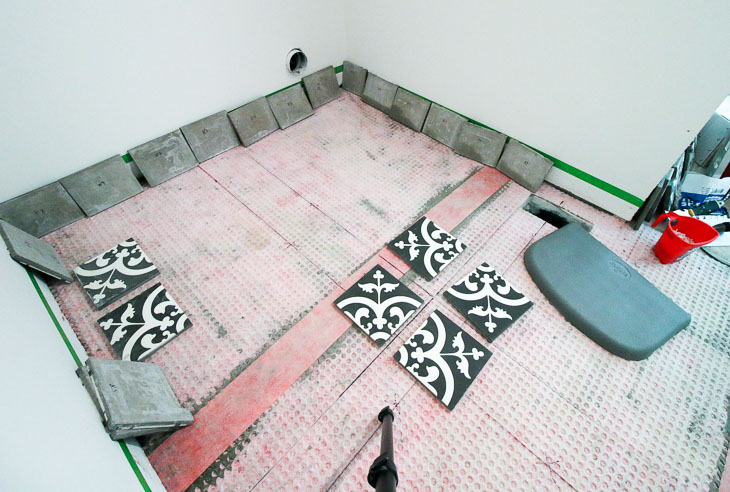 Layout cement tiles starting in the center.