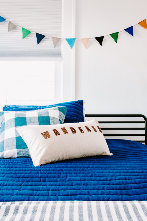 Insert your pillow form into your new felt letter pillow cover!