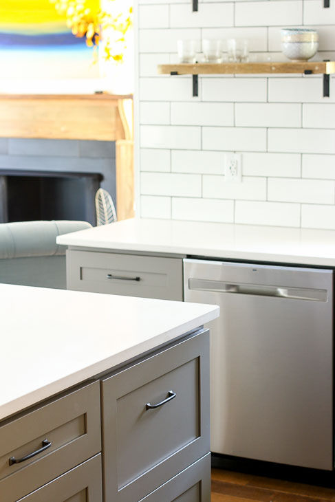 Gray shaker style kitchen cabinets and stainless steel dishwasher