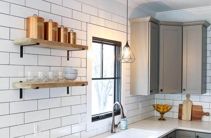 Open modern farmhouse shelves on subway backsplash