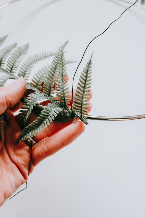 Snip off a piece of Floral Wire and Use this to Wrap your greenery around Hoop