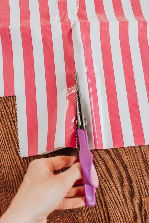 Cut out the two squares of oilcloth fabric that you previously measured