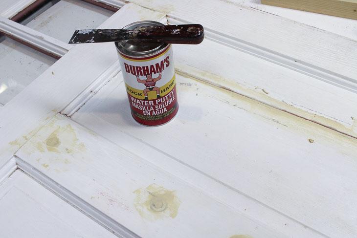 Add Durham Wood Hardener on back side of door repair