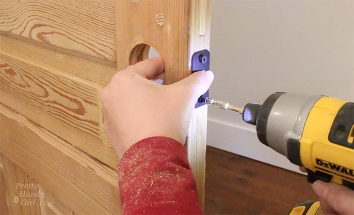 Attach face plate onto door edge