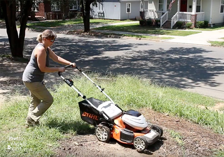 Brittany cutting thick lawn with STIHL RMA 460 mower