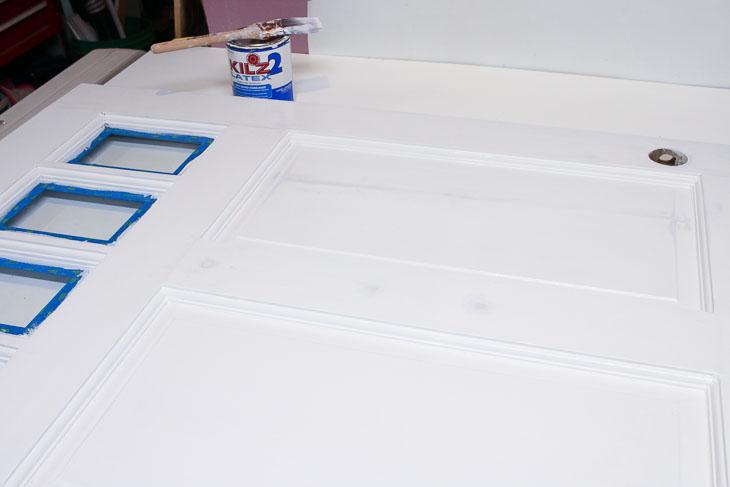 Prime repaired door with KILZ 2 primer