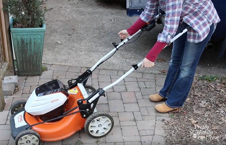 folding down mower handles