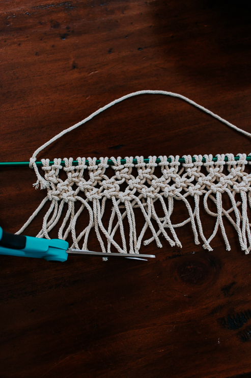 Trim the bottom of the wall hanging to even it up