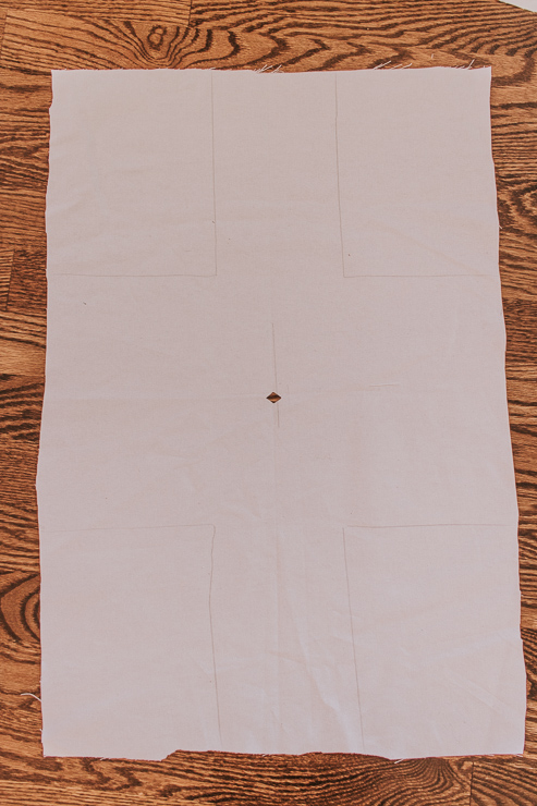 Create a hole in the center of the fabric