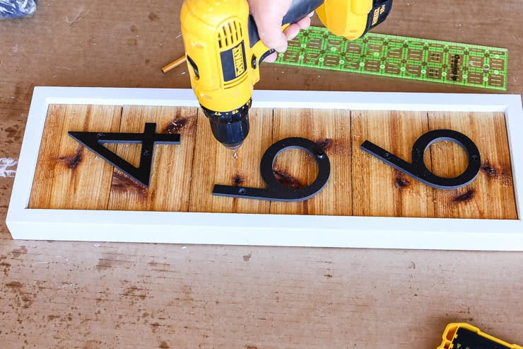 pre-drill holes of house numbers
