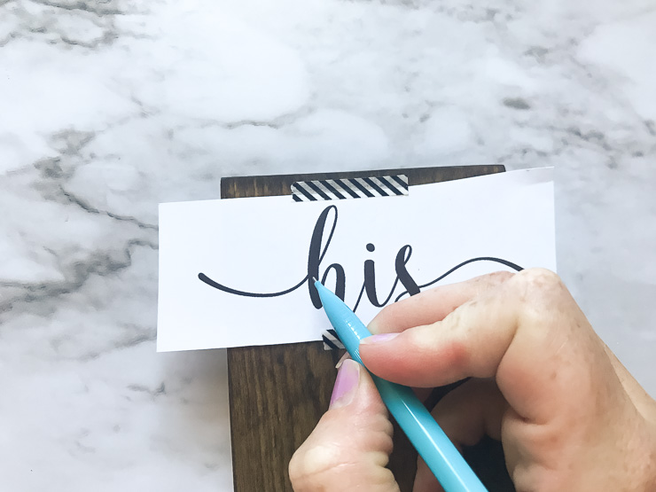 Use a pencil to trace over text onto the wood