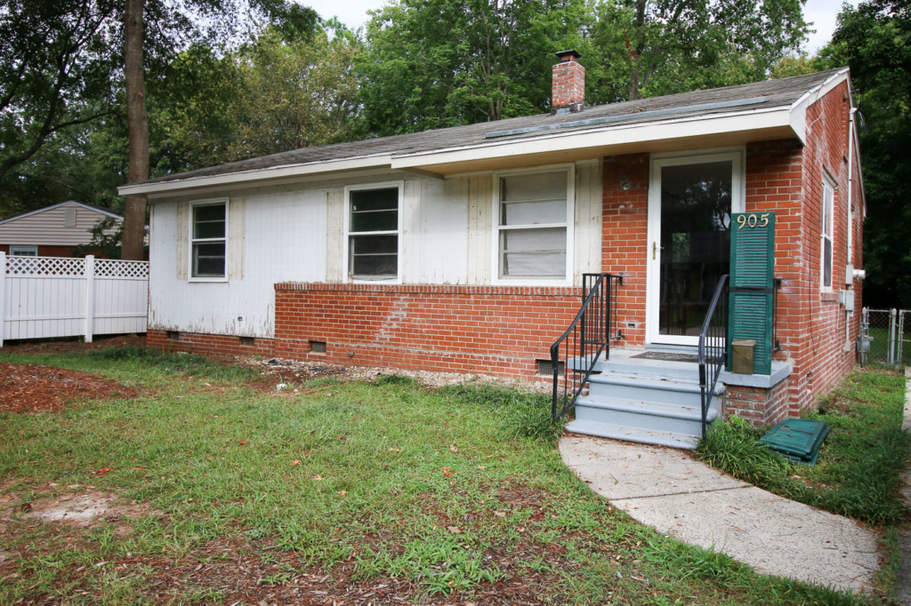 front brick ranch with original siding exposed