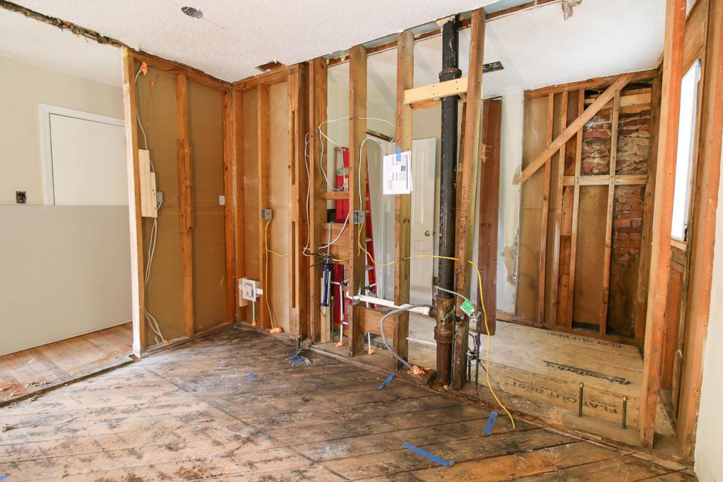 framing opening and plumbing run between kitchen bathroom