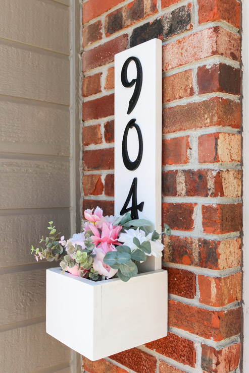 Finished view of house number planter box, filled with Spring florals