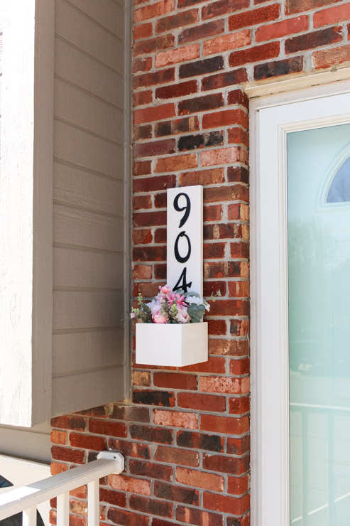 Finished exterior view of house number planter