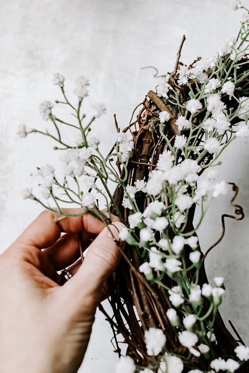 insert florals into grapevine wreath