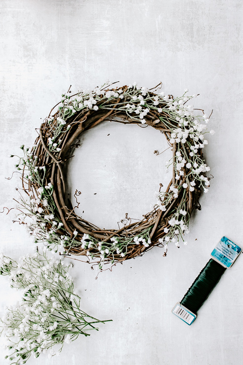 Use floral wire to secure florals to wreath