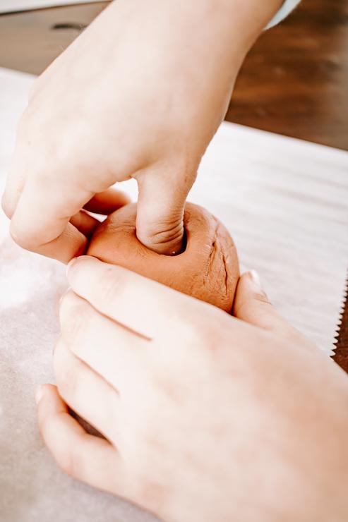 Push thumb into center of clay