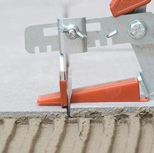 wedge shaped tile spacer leveling two tiles