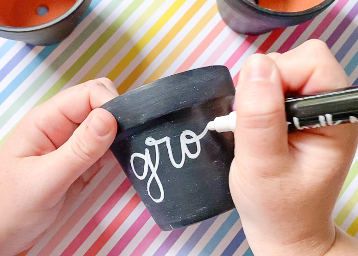 """lettering """"grow"""" on chalkboard planter"""