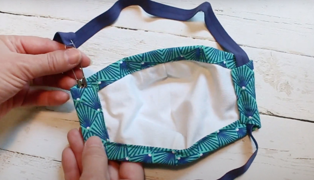 feed straps through mask