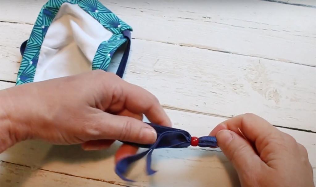 feeding adjustment bead onto face mask straps