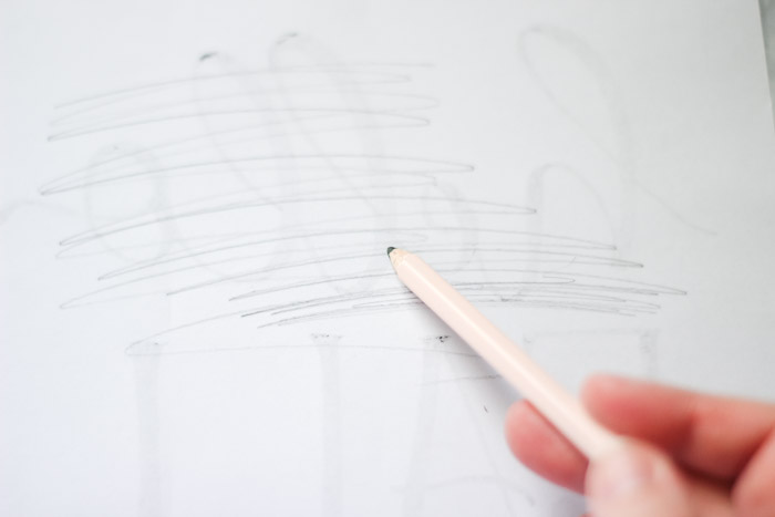 shading over back of design with pencil