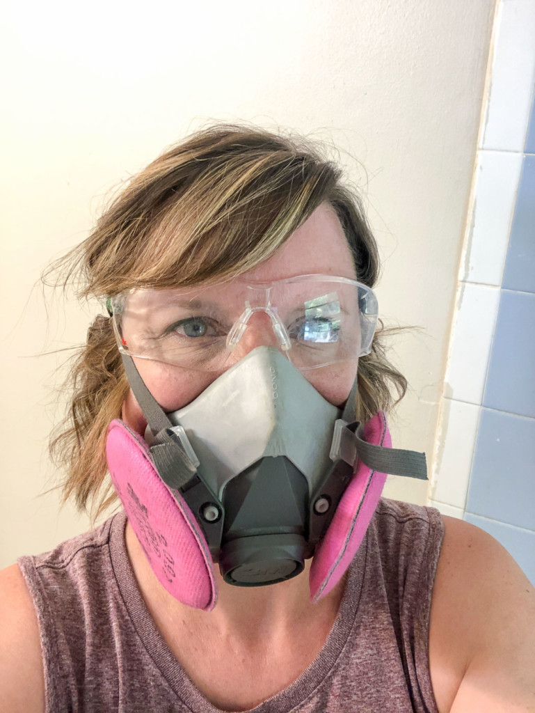 PHG with respirator and safety glasses on