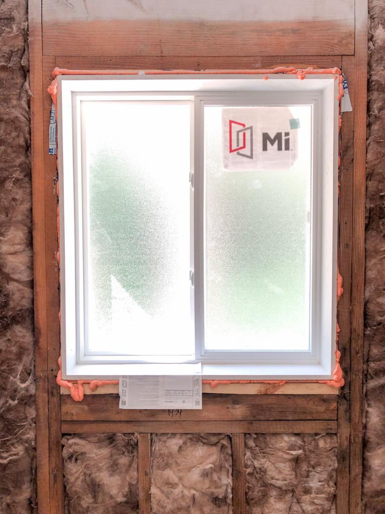 installed new vinyl slider window in shower area